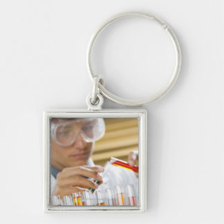 Boy pouring mixture from test tube keychain