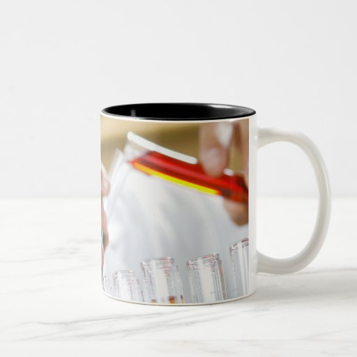 Boy pouring mixture from test tube Two-Tone coffee mug
