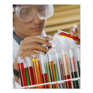 Boy pouring mixture from test tube poster