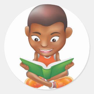 boy reading a book classic round sticker