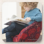 Boy reading a book drink coasters