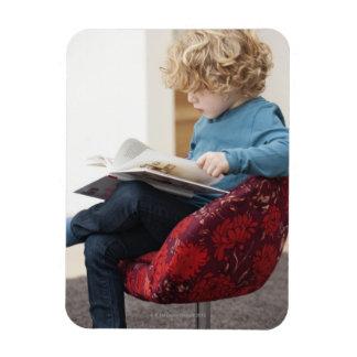 Boy reading a book magnet