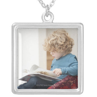 Boy reading a book silver plated necklace
