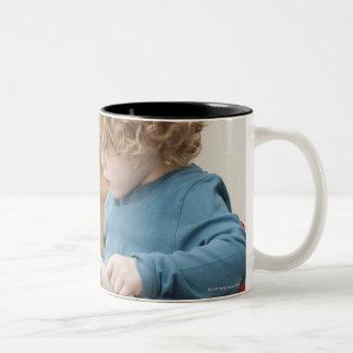 Boy reading a book Two-Tone coffee mug