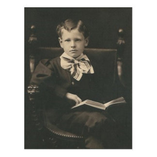 boy reading book post card