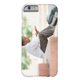 Boy reading on steps outside school, barely there iPhone 6 case