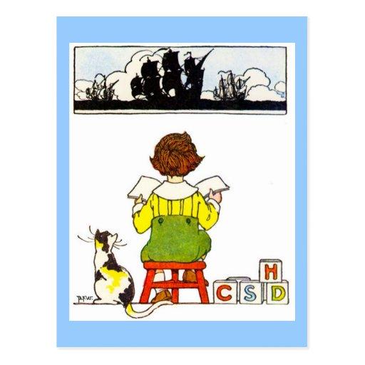 Boy reading postcards
