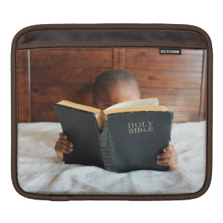 Boy Reading the Holy Bible iPad Sleeves