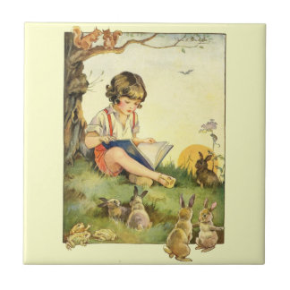Boy reading under tree with rabbits ceramic tile