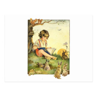 Boy reading under tree with rabbits postcard
