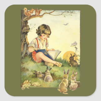 Boy reading under tree with rabbits square sticker