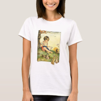 Boy reading under tree with rabbits T-Shirt