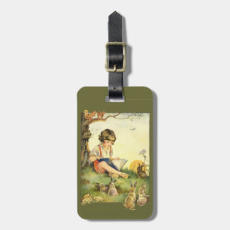 Boy reading under tree with rabbits tag for luggage