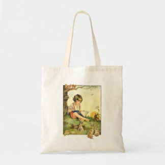 Boy reading under tree with rabbits tote bag