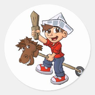 Boy riding a stick horse. classic round sticker
