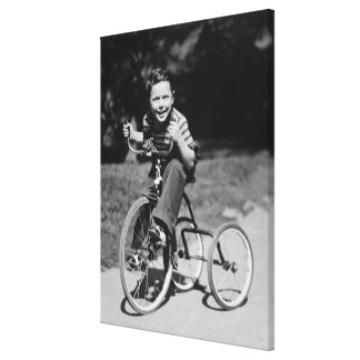 Boy Riding Tricycle Canvas Print