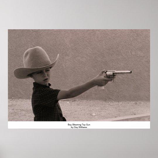 Boy Shooting Toy Gun Poster