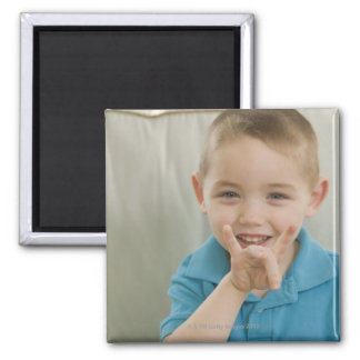 Boy signing the number '8' in American sign 2 Inch Square Magnet