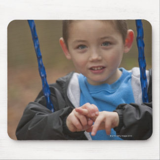 Boy signing the word 'Swing' in American Sign Mouse Pad