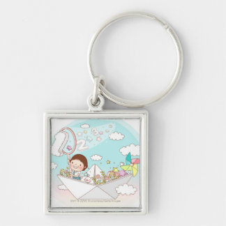 Boy sitting in paper boat keychain