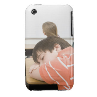 Boy sleeping on desk in classroom iPhone 3 cover