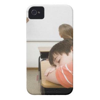 Boy sleeping on desk in classroom iPhone 4 Case-Mate case