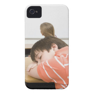 Boy sleeping on desk in classroom iPhone 4 cover
