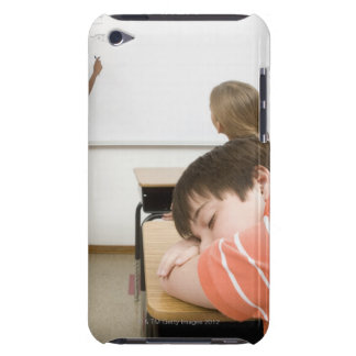 Boy sleeping on desk in classroom iPod touch case