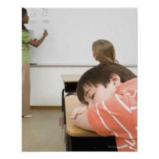 Boy sleeping on desk in classroom poster