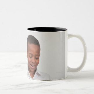 Boy standing in front of class reading in 2 Two-Tone coffee mug
