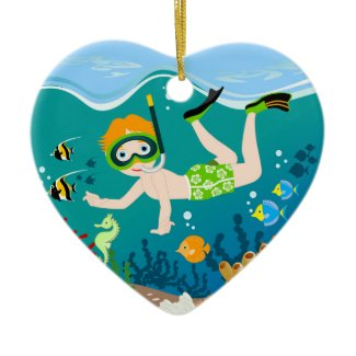 Boy swimming and diving with tropical fish christmas tree ornaments