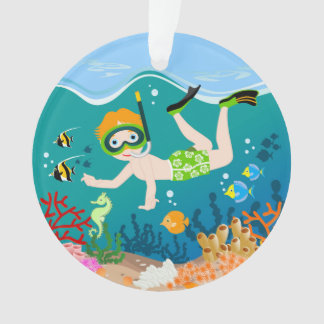 Boy swimming and diving with tropical fish ornament