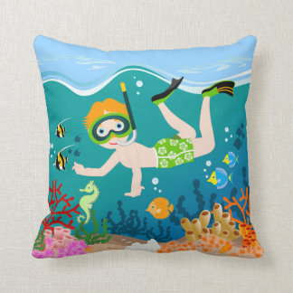Boy swimming and diving with tropical fish throw pillow