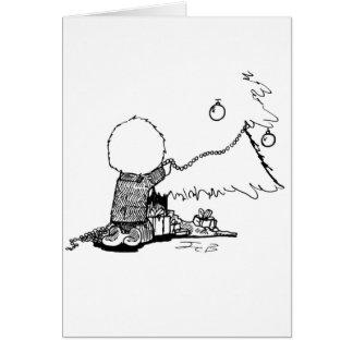 Boy trimming Christmas Tree Card