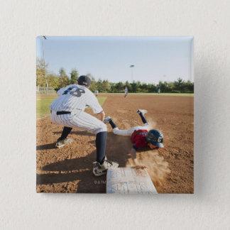 Boys (10-11) playing baseball button