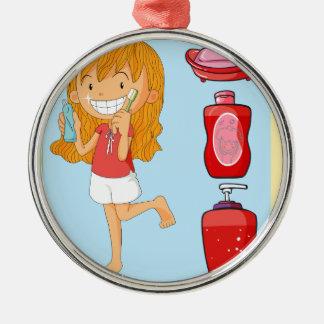 Boys and girl brushing teeth metal ornament