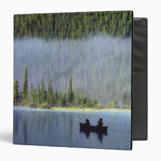 Boys fishing from canoe with mist in 3 ring binder
