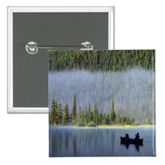 Boys fishing from canoe with mist in 2 inch square button