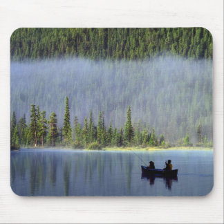 Boys fishing from canoe with mist in mouse pad
