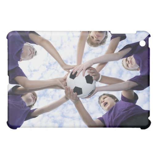 Boys holding soccer ball in huddle case for the iPad mini