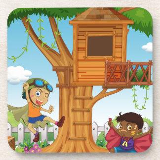 Boys playing in the garden coaster