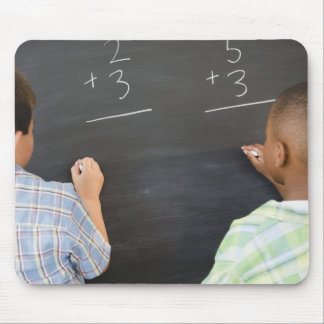 Boys solving math problems on blackboard mouse pad