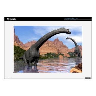 Brachiosaurus dinosaurs in water - 3D render Skins For Laptops