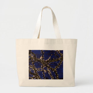 Branches with Christmas lights and a dark blue sky Large Tote Bag