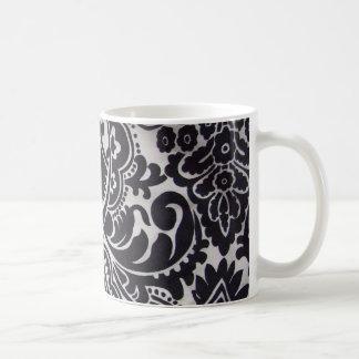 branco del preto e del abtrato del padrão taza básica blanca