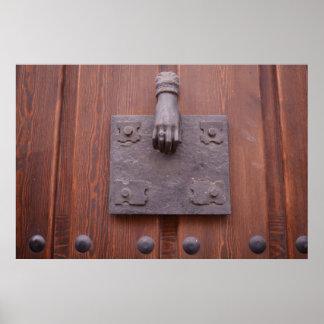 Brass hand door knocker Poster
