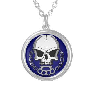 Brass knuckles skull necklace