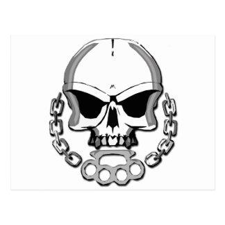 Brass knuckles skull postcard