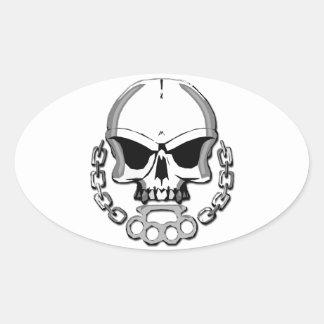 Brass knuckles skull oval sticker