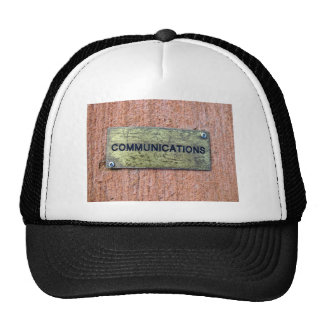 Brass plate on concrete wall mesh hat
